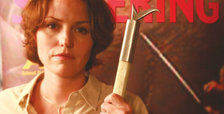 Jorja Fox stands holding a bullhook, as used in the training of circus elephants